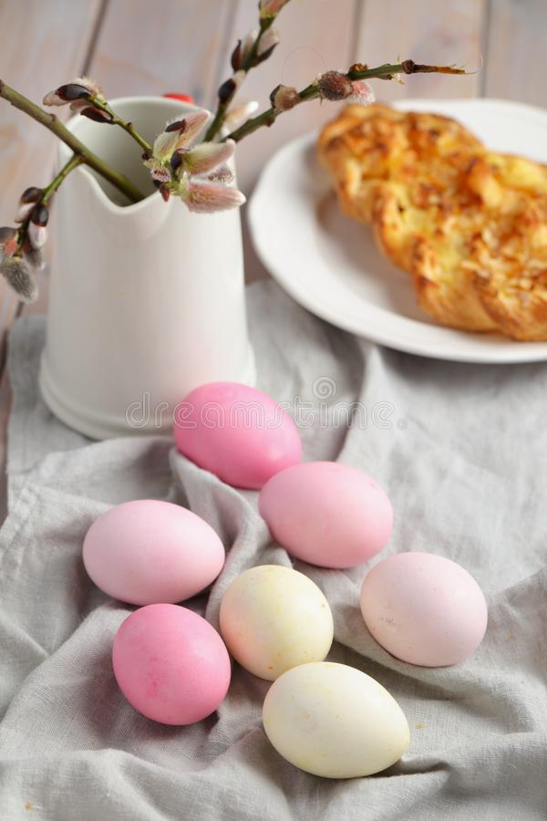 Easter eggs and bunch of willow branches royalty free stock photo
