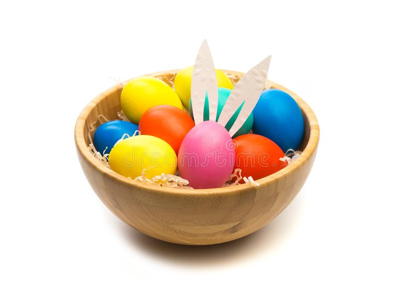 Easter eggs with bunny ears in bowl isolated royalty free stock image