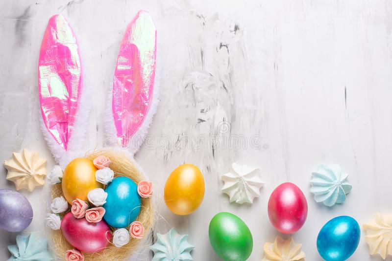 Easter eggs with bunny ears on a marble background. Lay lay with space for design. Horizontal composition. Greeting card concept royalty free stock images