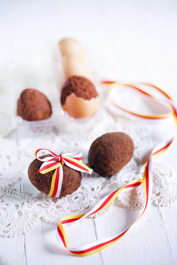 Easter eggs cake, chocolate muffins egg shaped, tied with riibbon royalty free stock photo