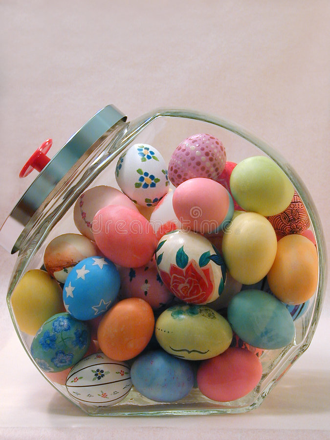 Easter Eggs in a Candy Jar. A Jar full of colored Easter eggs royalty free stock images