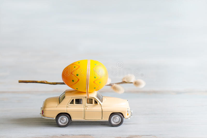 Easter eggs and catkins on car abstract retro concept. Closeup stock images