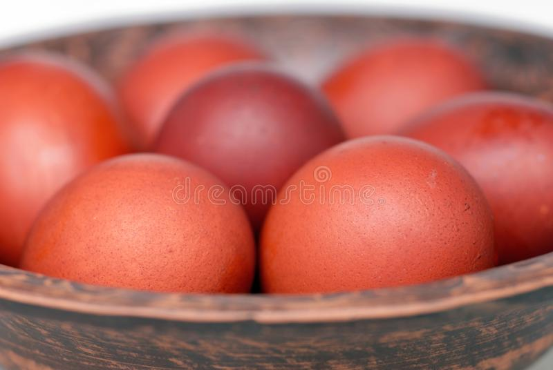 Easter eggs in a ceramic plate in front of a light background royalty free stock photos