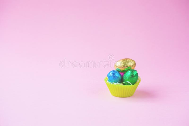 Easter Eggs Chocolates mini basket pink background.  stock photography