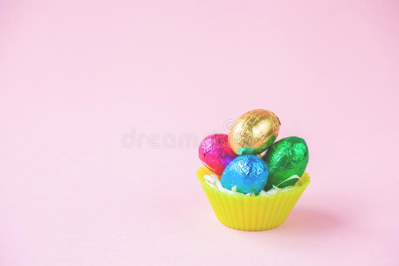 Easter Eggs Chocolates mini basket pink background.  stock images