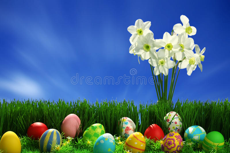 Easter eggs collection and flowers stock photography