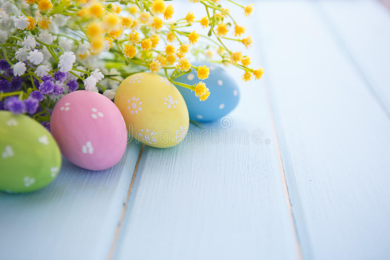 Easter Eggs. Colorful decorated easter eggs on white wood background. Happy Easter stock photo