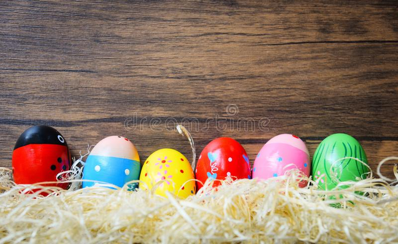 Easter eggs colorful decoration wooden wall background royalty free stock photography