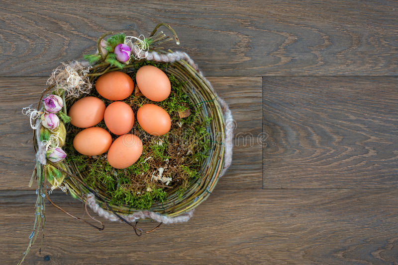 Easter eggs composition top view wooden background stock image