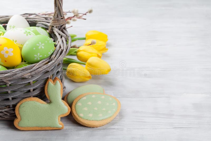 Easter eggs, cookies and tulip flowers royalty free stock photo