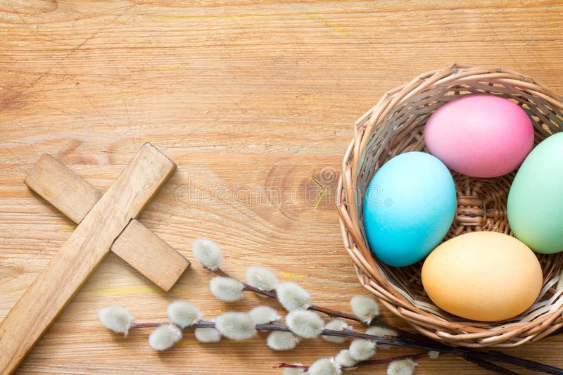 Easter eggs and cross on abstract wooden spring background stock image