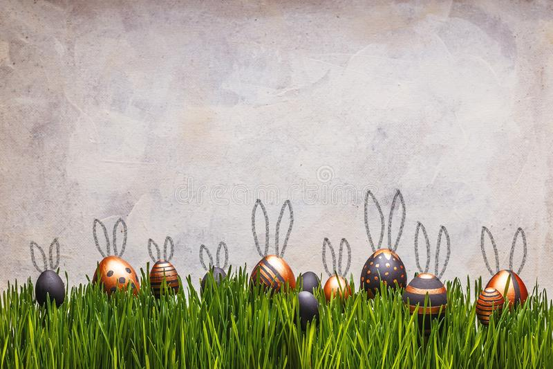 Easter eggs with cute bunny`s ears royalty free stock photos