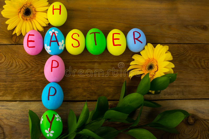 Easter eggs and daisy stock photo
