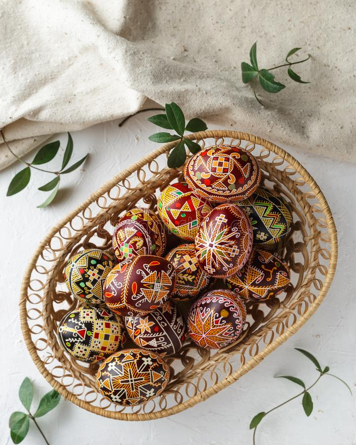 Easter eggs decorated with wax resist technique. Big woven dish with Pysanky. Ukrainian Easter eggs decorated with wax-resist dyeing technique, traditional for royalty free stock image