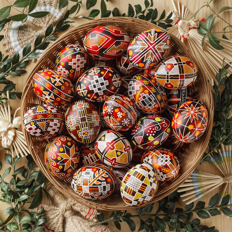 Easter eggs decorated with wax resist technique. Big woven dish with Pysanky. Ukrainian Easter eggs decorated with wax-resist dyeing technique, traditional for royalty free stock photo