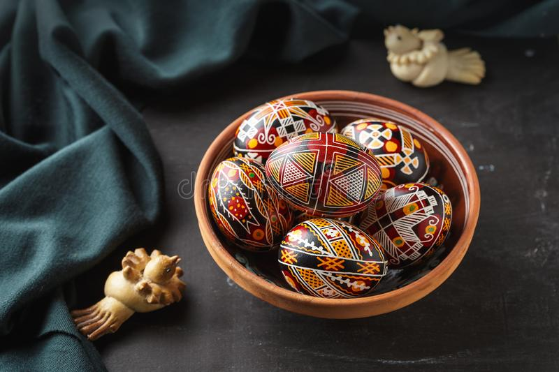 Easter eggs decorated with wax resist technique. Pysanky in a bowl, Ukrainian Easter eggs decorated with wax-resist dyeing technique, traditional for Eastern royalty free stock photo