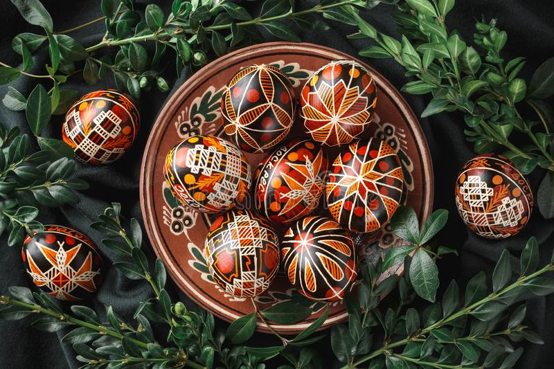 Easter eggs decorated with wax resist technique. Pysanky on a plate, Ukrainian Easter eggs decorated with wax-resist dyeing technique, traditional for Eastern royalty free stock image
