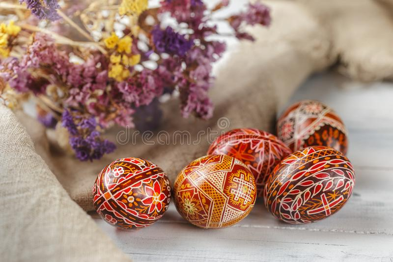 Easter eggs decorated with wax resist technique. Pysanky, Ukrainian Easter eggs decorated with wax-resist dyeing technique, traditional for Eastern European stock photo