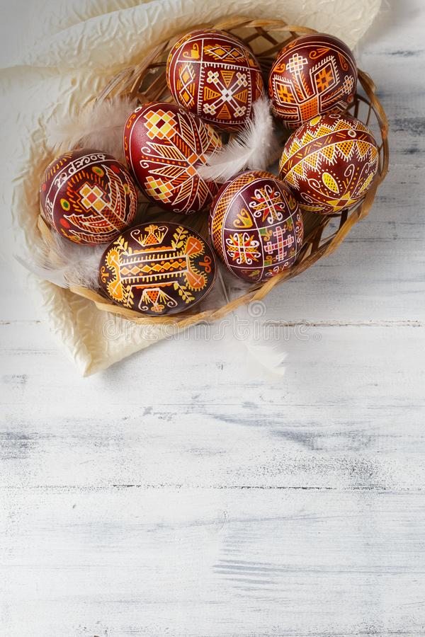 Easter eggs decorated with wax resist technique. Pysanky, Ukrainian Easter eggs decorated with wax-resist dyeing technique, white wooden background, copy space stock photos