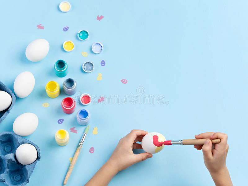 Easter eggs decorating activity. royalty free stock photos