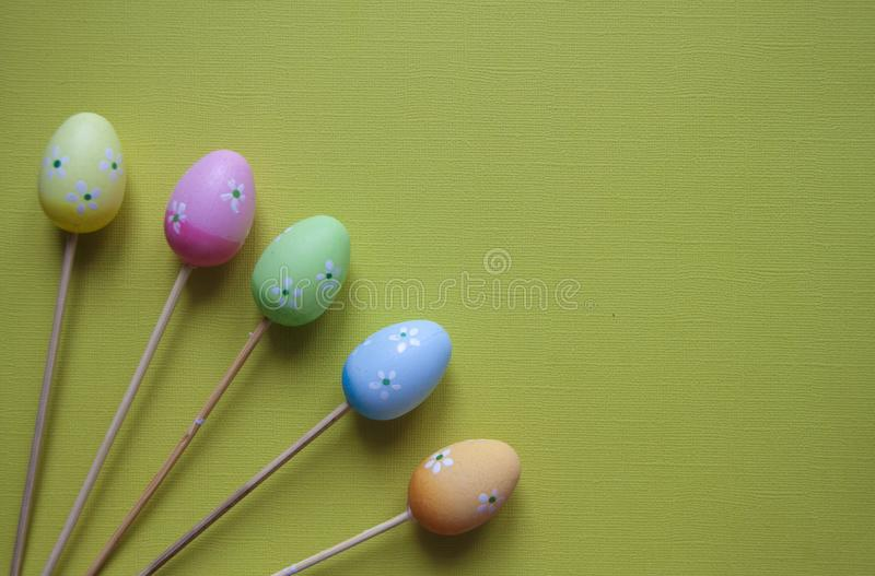 Easter eggs decoration figures on green background. Easter backdrop stock images