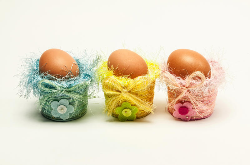 Easter eggs in decorative small baskets royalty free stock image