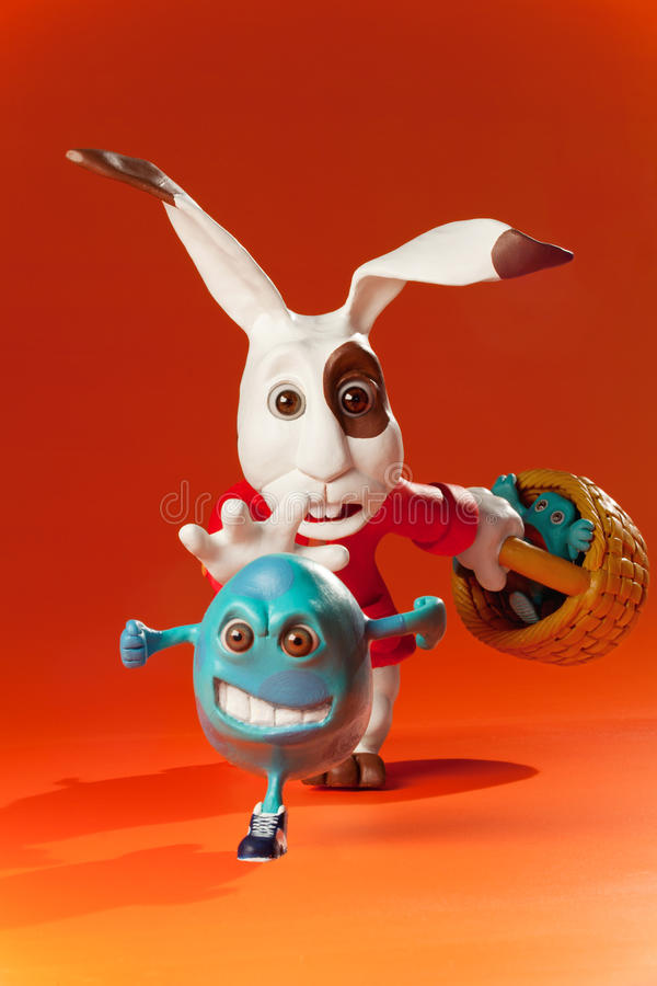Easter eggs escape from rabbit. Iconography of Easter rabbit and eggs. Creative vision fun stock illustration