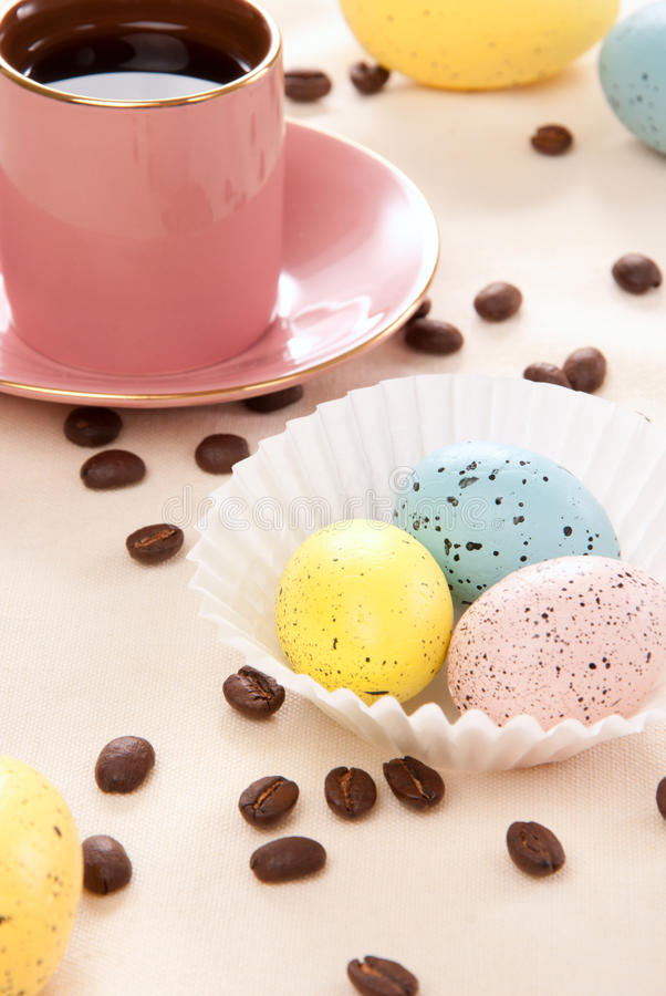 Easter eggs and espresso coffee cup stock photography
