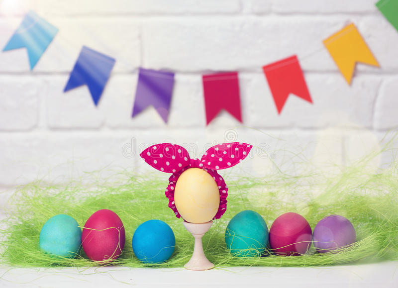 Easter eggs and flags. decoration for Easter holiday with easy DIY Easter flags. Do-it-yourself style selective focus. stock photography