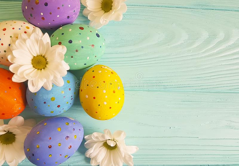 Easter eggs tradition flowers rustic pattern blue wooden background place for text royalty free stock images