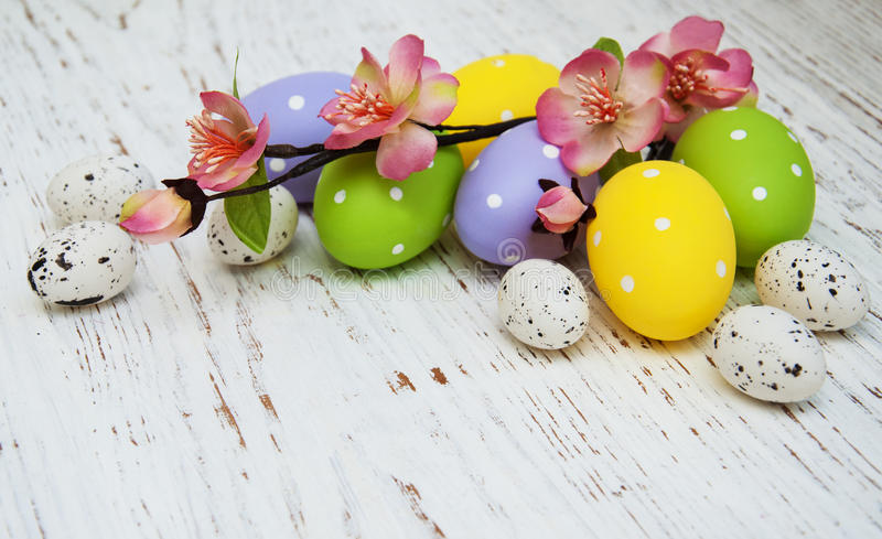 Easter eggs. With flowers on a old wooden background royalty free stock photos