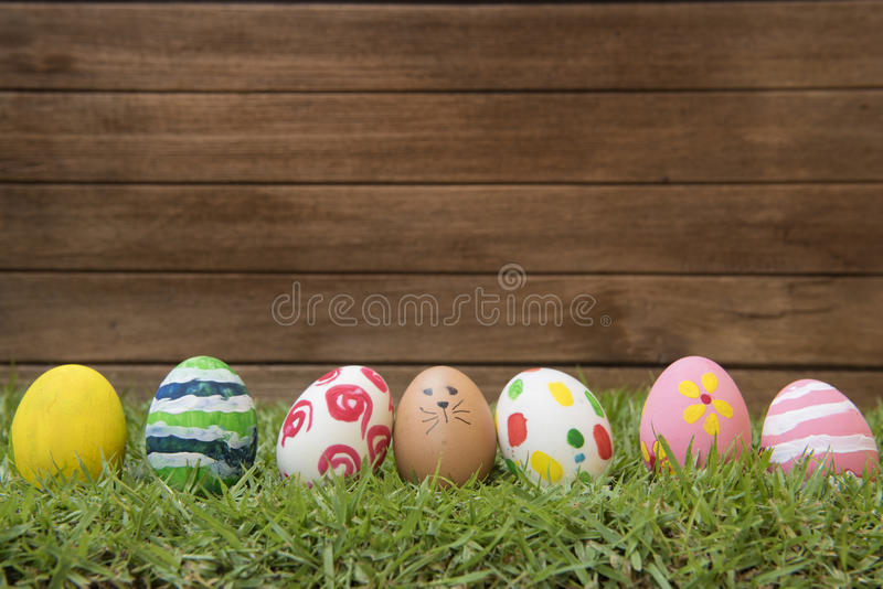 Easter eggs and in green grass stock photos