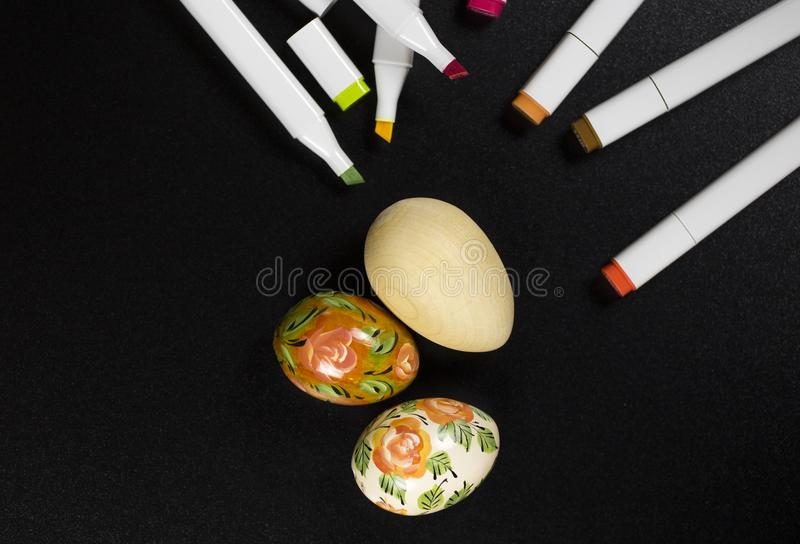 Easter eggs hand painted and blanks for coloring royalty free stock photography