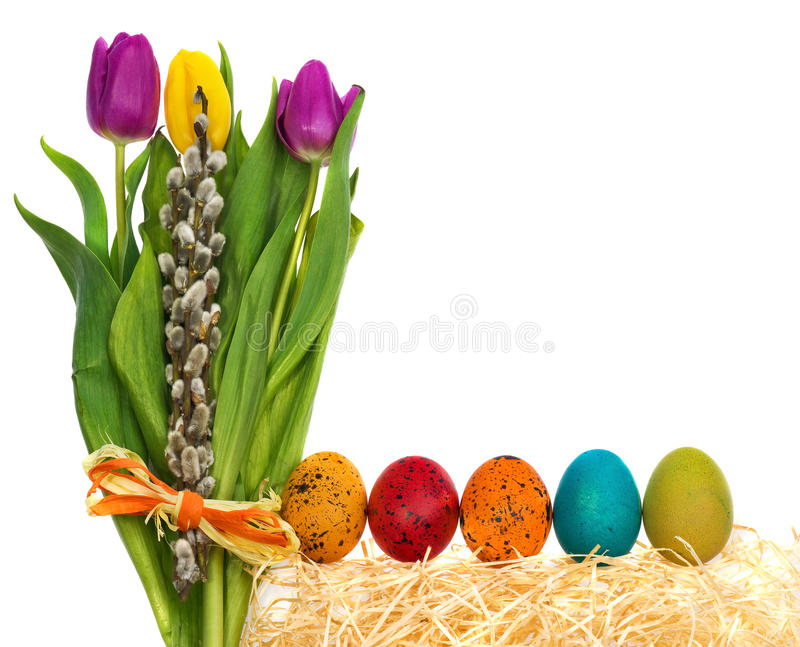 Easter eggs hand painted with a bouquet of flowers tulips, catkins. stock photos