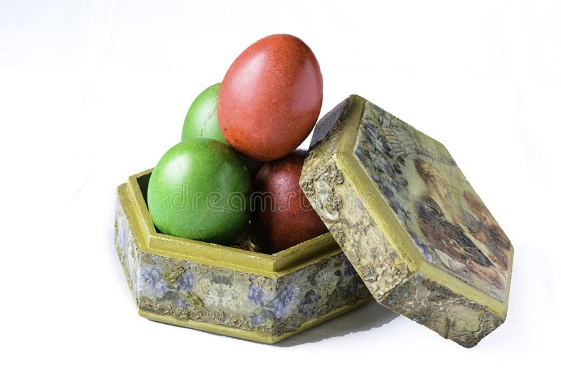 Easter eggs on a handmade box isolated on White. royalty free stock image