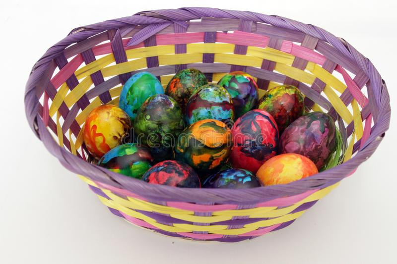 Easter eggs. Handmade painted eggs in basket for Easter celebration isolated on white background. Easter. Colored Easter eggs royalty free stock images
