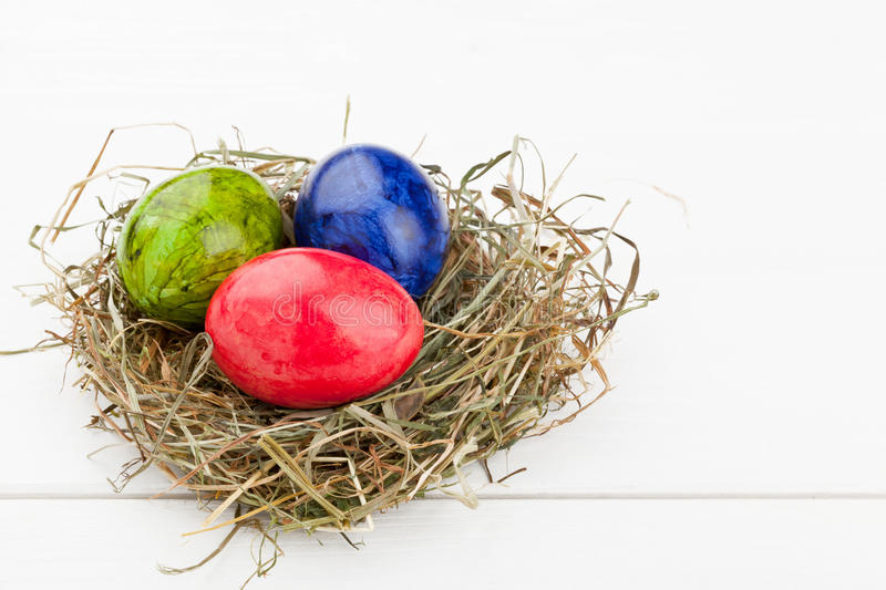 Download Easter Eggs In Hay Nest On White Wood Stock Image - Image of colorful, nobody: 39506151