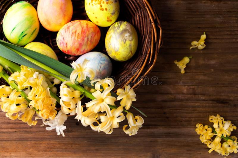 Easter eggs and hyacinth spring flowers stock image