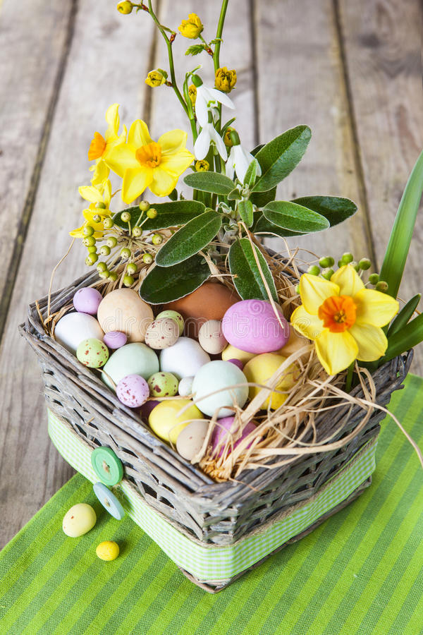 Free Easter Eggs In The Basket On Green Striped Cloth Stock Photo - 56690370