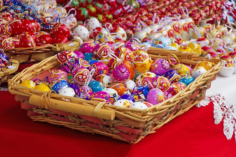 Easter eggs in a knit basket. Easter eggs in a knit wooden basket stock photos