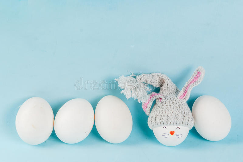 Easter eggs looking like bunnies stock images