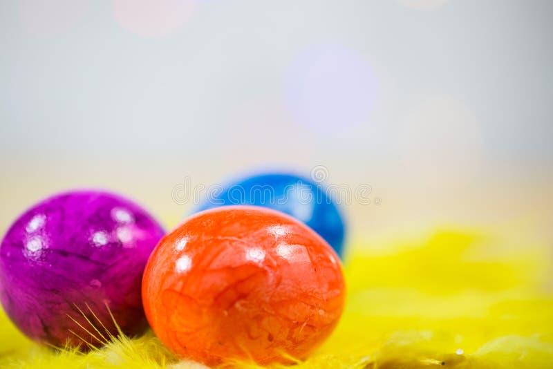 Easter eggs macro, on yellow feathers. Background stock image
