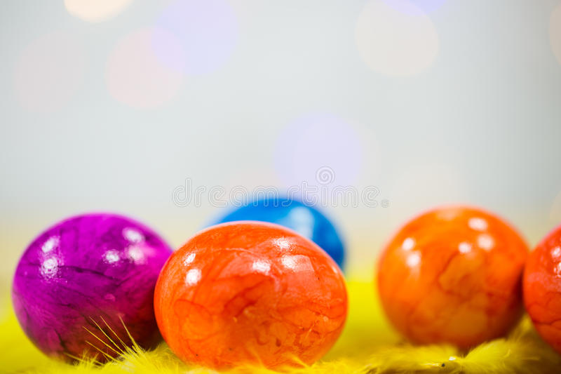 Easter eggs macro, on yellow feathers. Background royalty free stock photos