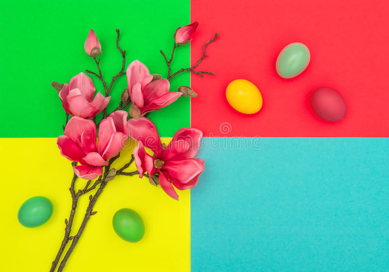 Easter eggs magnolia blossoms Spring flowers decoration. Easter eggs and magnolia blossoms on colorful background. Spring flowers easter decoration royalty free stock photo