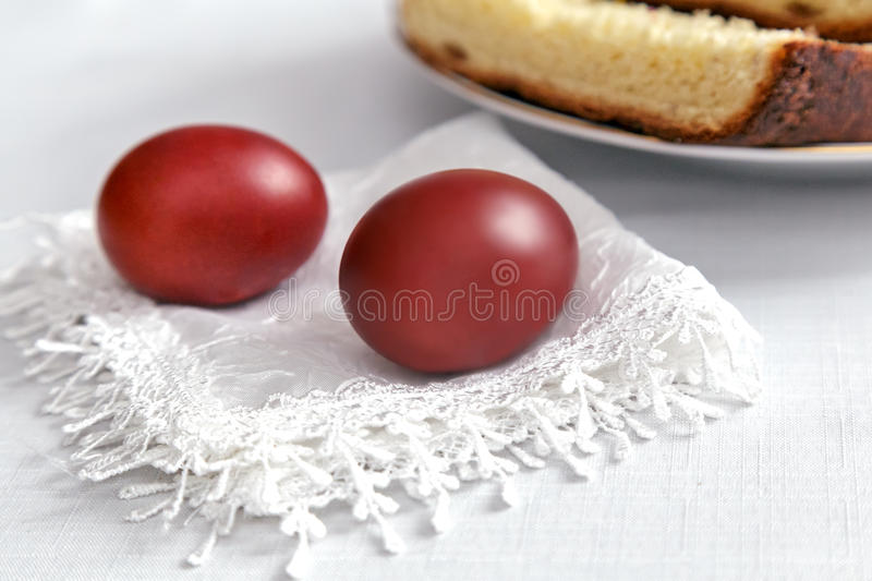 Easter eggs on the napkin and cake . royalty free stock photography