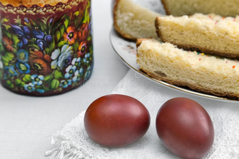 Easter eggs on the napkin and cake . royalty free stock photo