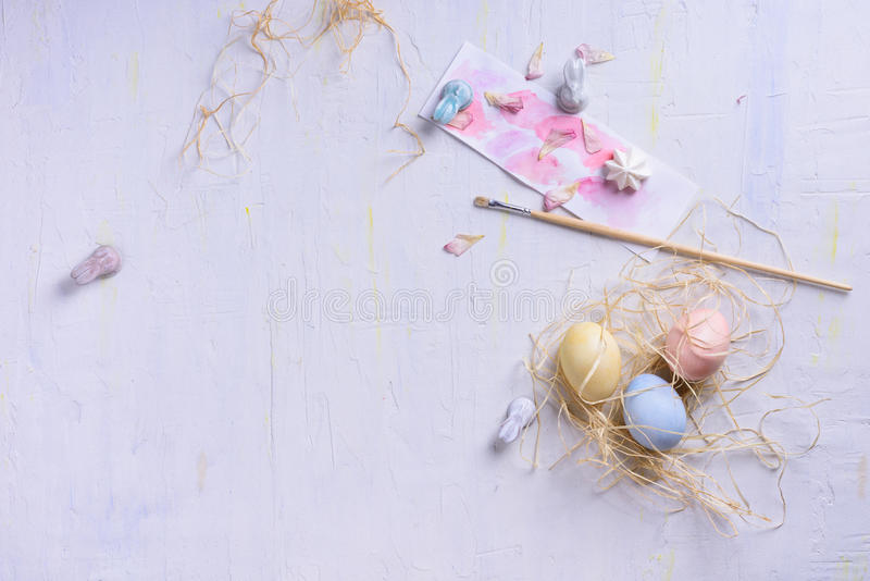 Easter eggs in a nest, pastel colors, spring holiday light background modern style. View from above, copy space. Happy royalty free stock image
