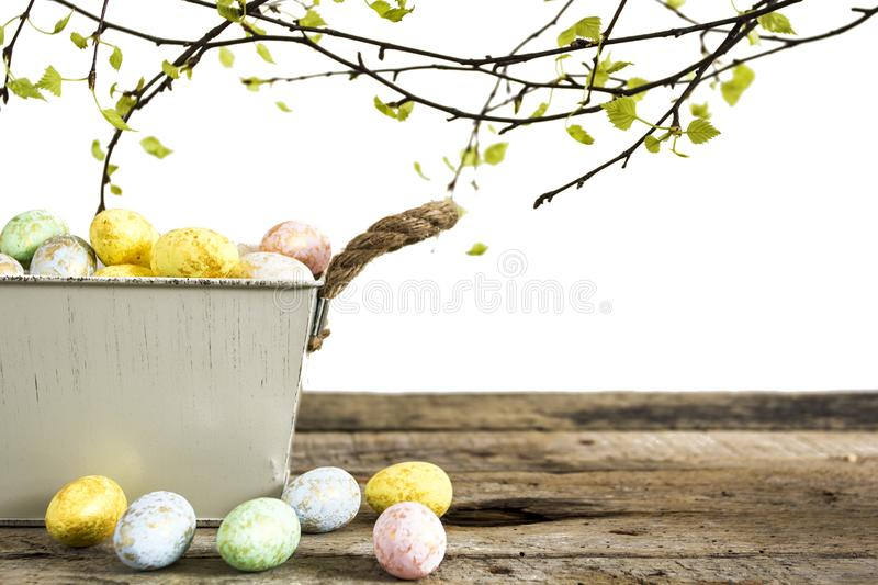 Easter eggs on old wooden table isolated on white background. stock photos