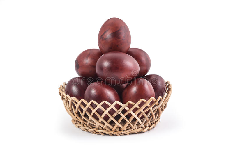 Easter eggs. Onion shell easter eggs in basket on white background royalty free stock image