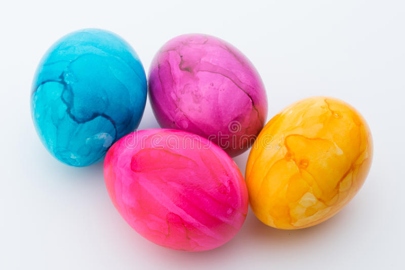 Easter eggs painted in colors on a white background. Bright, colorful Easter eggs in on white royalty free stock photos
